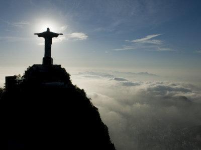 Christ the Redeemer Statue at Sunrise Above the Clouds