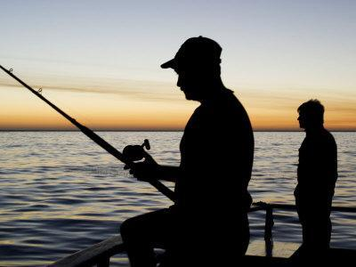 Fishing for Yellowfin Tuna from a Boat in Pre Dawn Light