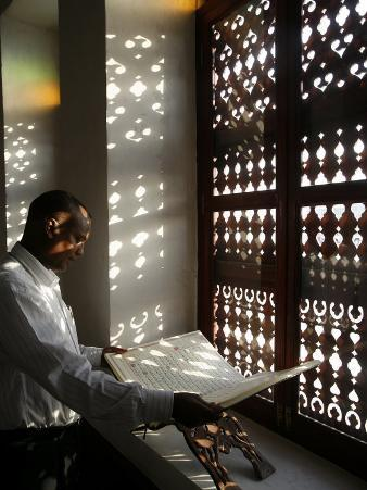 Man Reading the Koran in a Doha Mosque, Doha, Qatar, Middle East