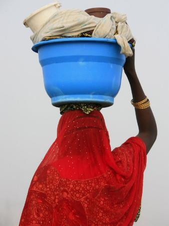 Woman Carrying a Bowl on Her Head, Saint Louis, Senegal, West Africa, Africa