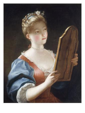A Young Girl Looking in a Mirror