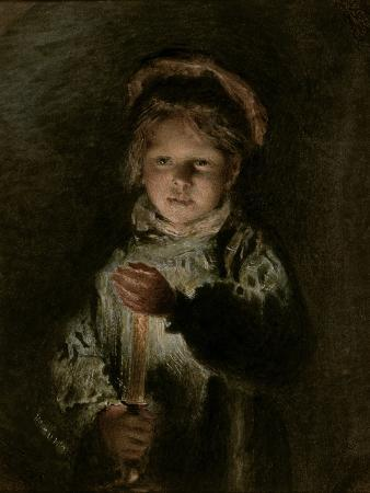 Young Boy Holding a Candle