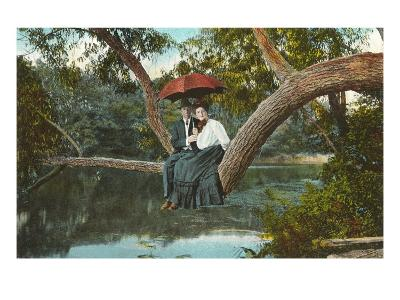 Couple on Tree Branch over Stream