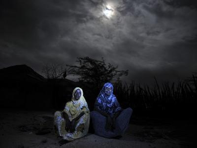 Halima Aden, Left, and Rhadija Aden, Sit Next to their Home in Garissa, Eastern Kenya