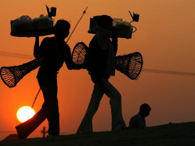 Indian Vendors Return Home after Selling Snacks at Sangam in Allahabad, India