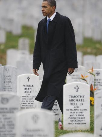 President Barack Obama Walks Through Grave Markers During a Visit to Arlington National Cemetery