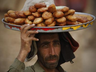Pakistani Food Vender Displays Food as He Waiting for Customer in Islamabad, Pakistan