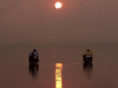Kashmiris Homeward on a Shikara, or Traditional Gondola, at Sunset on Dal Lake in Srinagar, India