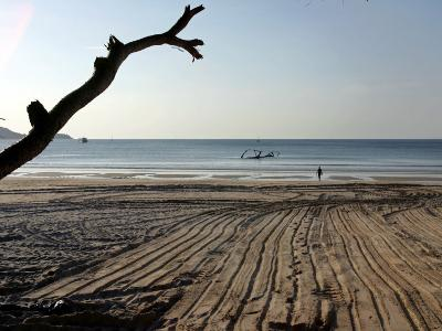 Foreign Tourist Walks Toward the Sea at Patong Beach