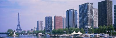 Skyscrapers at Waterfront with Tower in Background, Seine River, Eiffel Tower, Paris, France