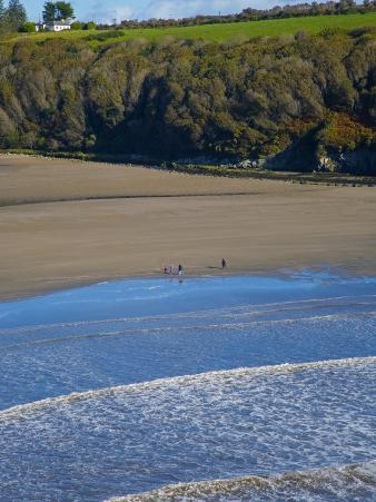 Walkers on Stradbally Strand, the Copper Coast, County Waterford, Ireland
