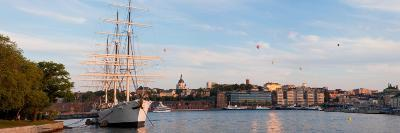 Schooner at Harbor with a City in Background with Hot Air Balloons in Sky, Stockholm, Sweden