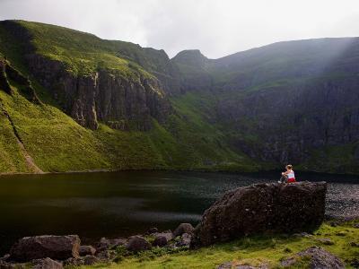 Young Woman Meditating, Coumshingaun Lough, Coeragh Mountains, County Waterford, Ireland