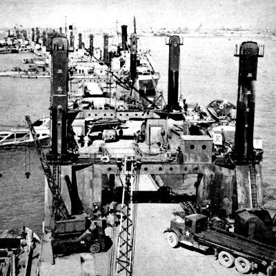 A Busy Wharf at 'Mulberry' Harbour; Second World War, 1944