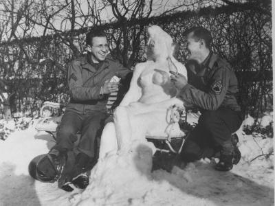 Offering their Anatomically Correct Snow Woman, Camel Cigarettes and a Coke in European Theater