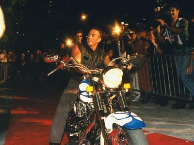 Jean-Claude Van Damme in Leather Vest, on Harley-Davidson Motorcycle, Outside Planet Hollywood