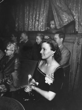"""Playwright Jean Kerr Holding a Rose Sitting in the Audience, Watches Her Play """"King of Hearts"""""""