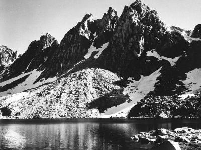 """Kearsarge Pinnacles,"" Partially Snow-Covered Rocky Formations Along the Edge of the River"