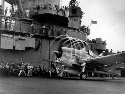 Crew Members on Deck of American Aircraft Carrier, Watching Take-Off of a F6F Hellcat