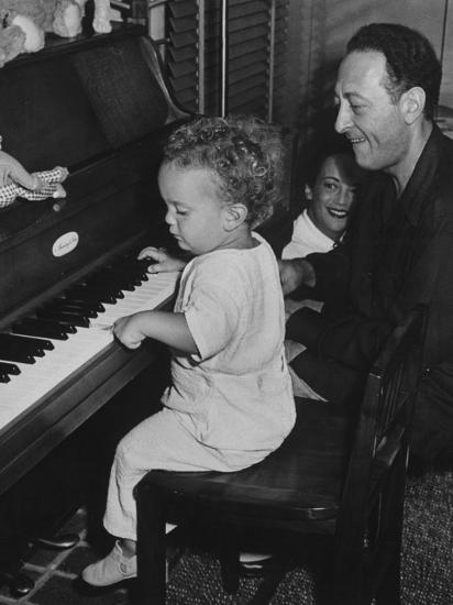 Violin Virtuoso Jascha Heifetz with Wife, Watching His Little Son Jay Hit  Keys on Piano