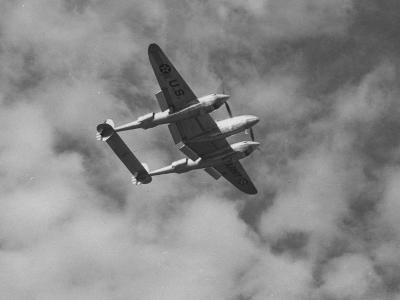 A P-38 Fighter Plane Soaring Through the Air