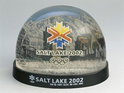 Figurines of 2002 Winter Olympics in a Snow Globe
