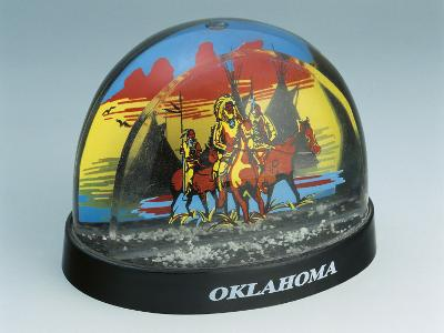 Close-Up of Figurines of Native American Horseback Riders in a Snow Globe