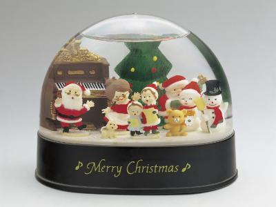 Close-Up of a Figurine of a Santa Claus with a Family in a Snow Globe