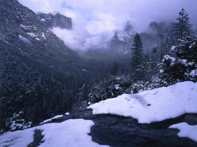 Winter Storm Begins to Clear as El Capitan and Bridal Veil Falls are Lightly Covered with Snow