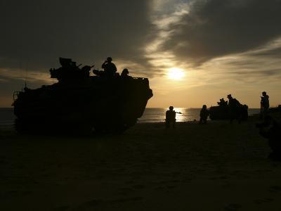 Silhouette of Marines and an Amphibious Assault Vehicle on Hwajin Beach, Republic of Korea