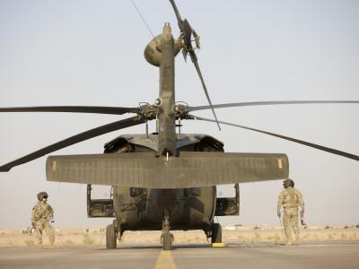 Crew Chiefs Stand Beside their UH-60L Black Hawk Helicopter