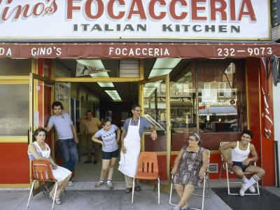 A Family Sits Outside Gino Pollari's Italian Restaurant in Brooklyn