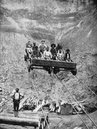A Group of Miners Rides the Cable Car Back and Forth from Work