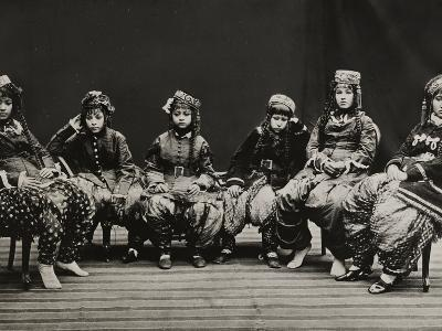 A Young Group of Well Dressed Nepali Women Sit for a Portrait