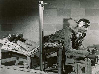 Researcher Tests a Pilot's Bed
