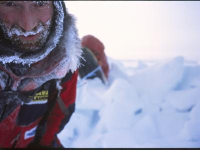 A Close View of an Explorer with Frost on His Hair and Clothing