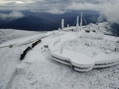 A Cog Railway Carries Visitors to the Top of the Snow Covered Peak