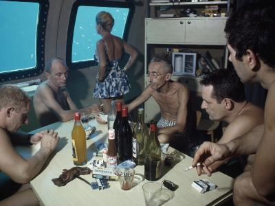 The Cousteaus and their Crew Relax in a Submersible after Work