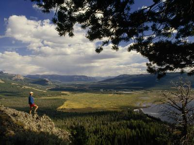 A Hiker Looks over the Teton Wilderness Area, Wyoming