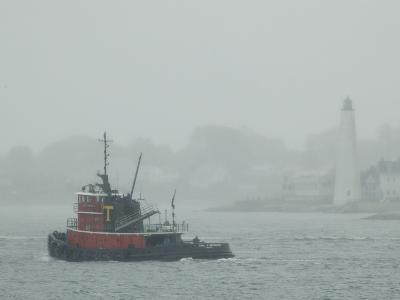 A Tugboat Travels Through Fog Past New London Harbor Light