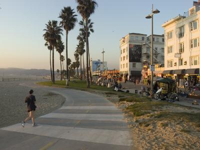 A Jogger on a Bike Path Along Venice Beach