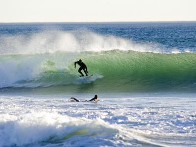 Surfers at Silver Strand Beach During a West December Swell