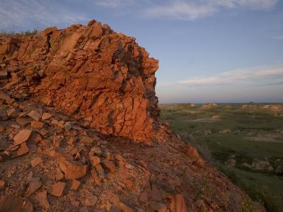 A Red Butte Reflects Late Afternoon Sun in Little Missouri Grasslands