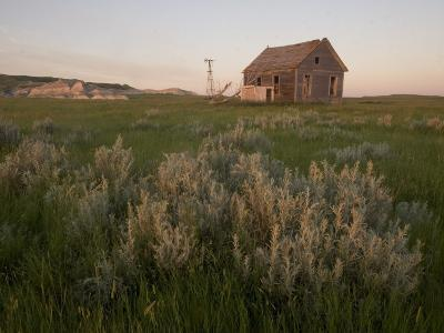 An Abandoned House Sits Near White Butte in the Grasslands