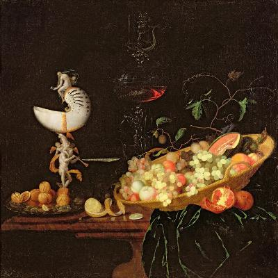 A Still Life of Fruit with a Nautilus Cup on a Draped Ledge