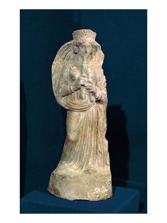 Statuette of a Woman Playing a Double Flute, from Tunisia