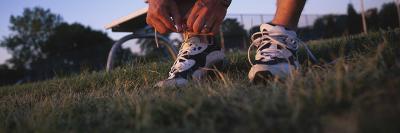 Man Tying His Shoe Lace, Illinois, USA