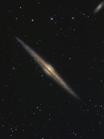 NGC 4565 is an Edge-On Barred Spiral Galaxy in the Constellation Coma Berenices