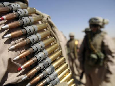 Belts of 50-Caliber Ammunition Hung from the Shoulders of Marines
