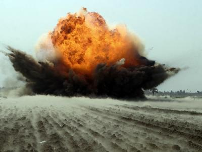 An Explosion Erupts from the Detonation of a Weapons Cache